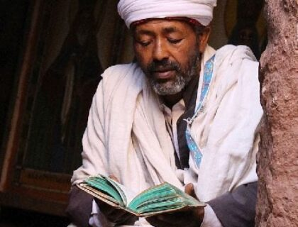 Priest Reading at Lalibela Church in Ethiopia